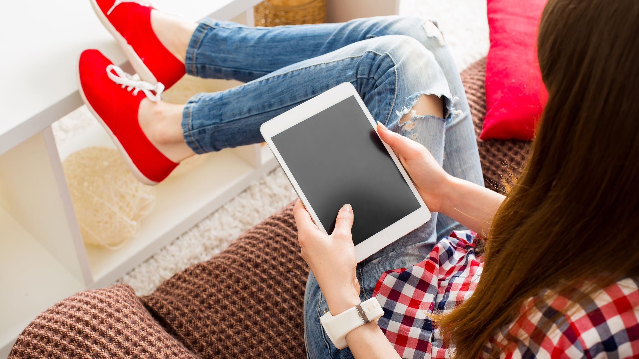 Woman at home relaxing on sofa couch reading email on the tablet computer wifi connection; Shutterstock ID 278640140; PO: Project Italy - Facilities images; Job: Project Italy - Facilities images; Client: H&J/Citalia