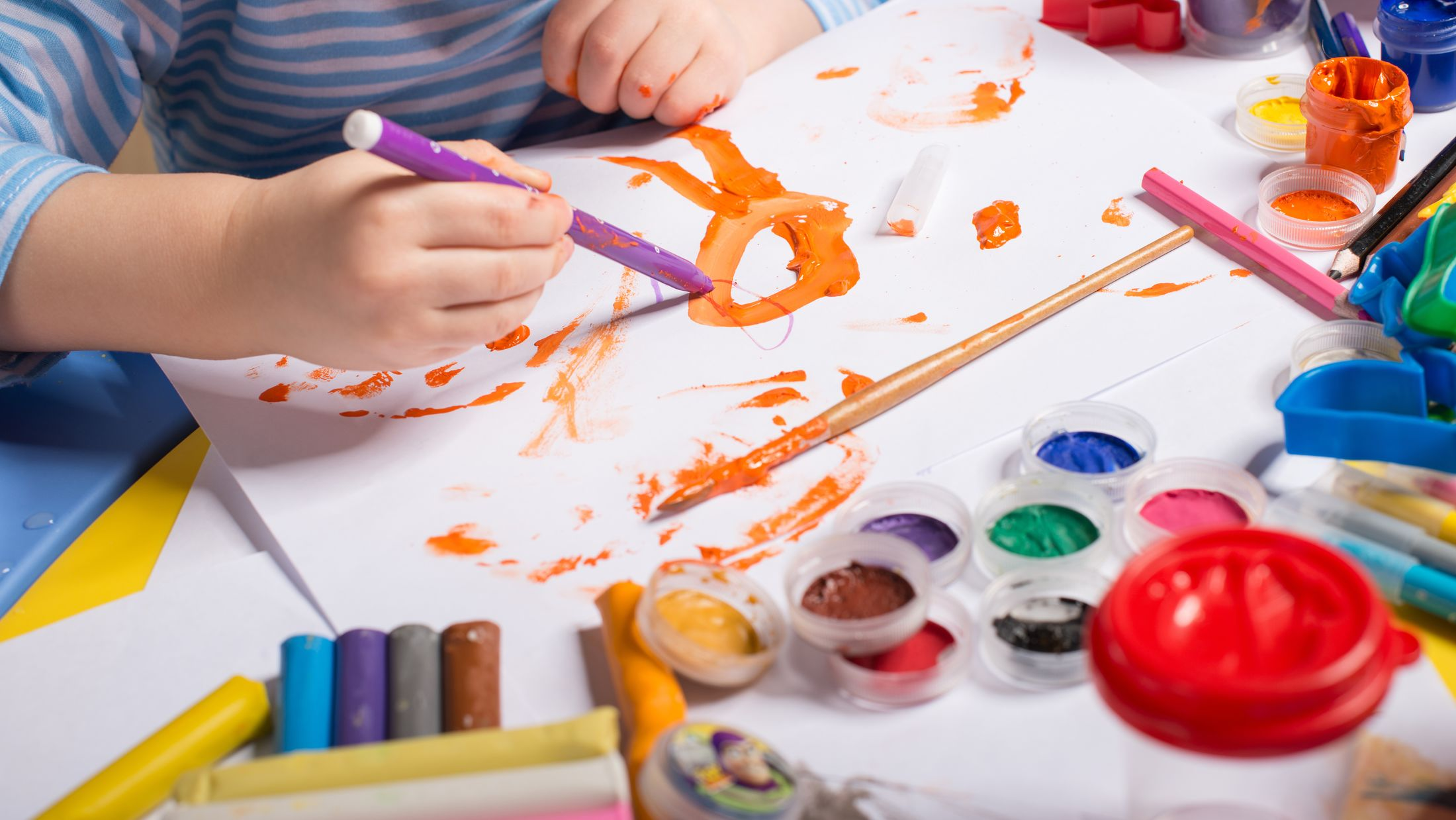 Hands of painting little boy and the table for creativity; Shutterstock ID 132261485; PO: Sovereign