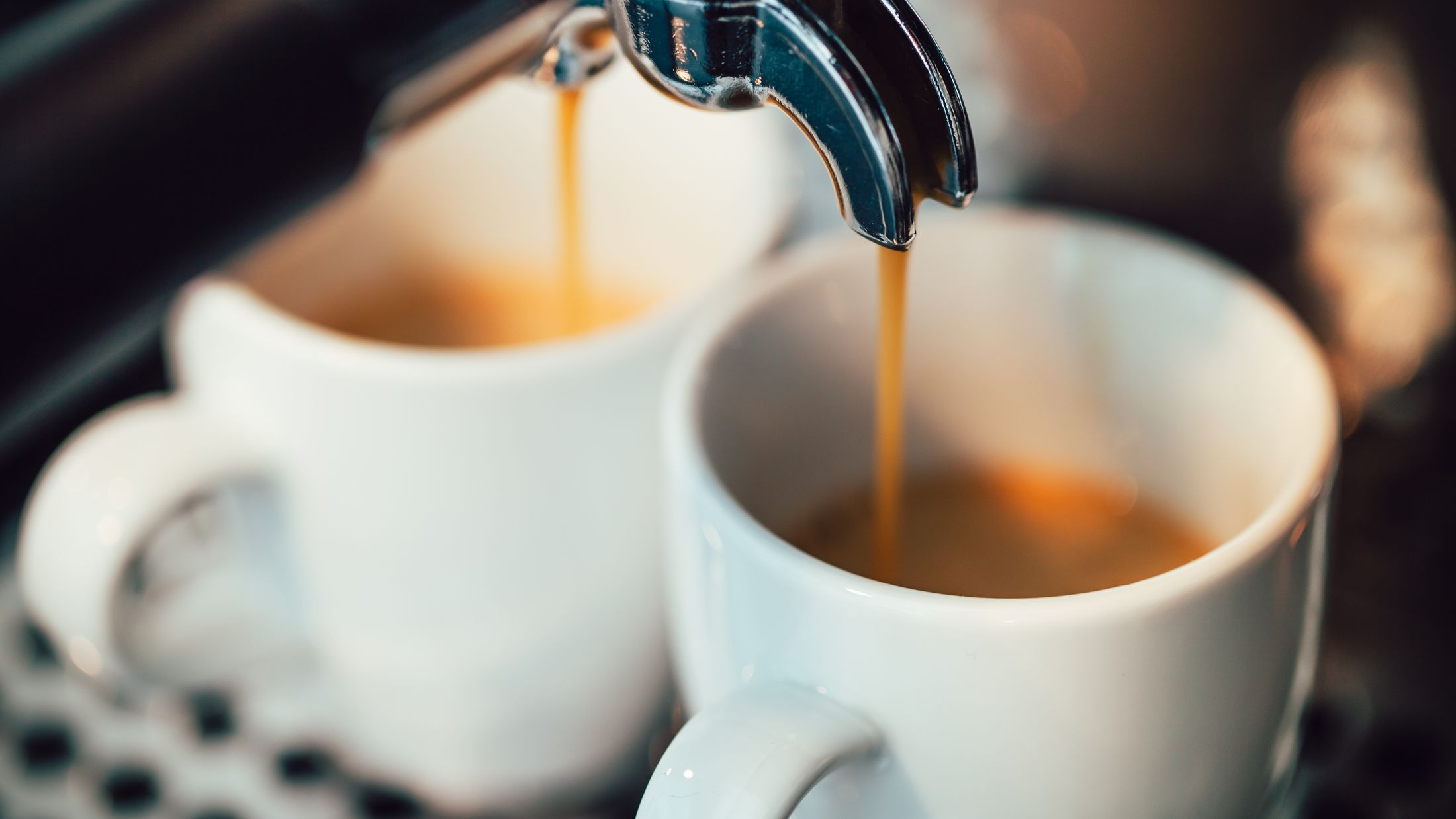 Close up image of espresso pouring into white cups; Shutterstock ID 386462938; PO: Project Italy - Facilities images; Job: Project Italy - Facilities images; Client: H&J/Citalia