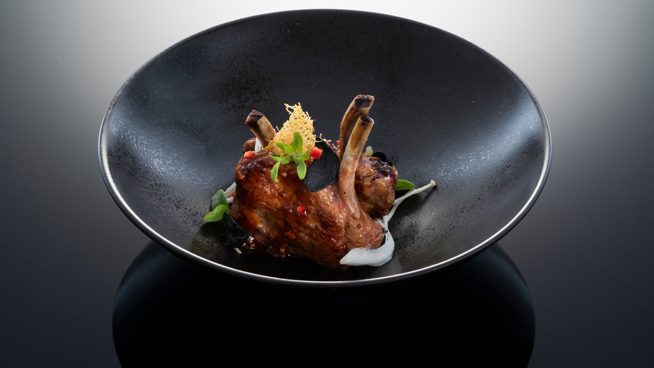 Hakkasan food shoot, Hakkasan Hanway Place. Wok-fry Australian lamb rack with black garlic: Dubai dish